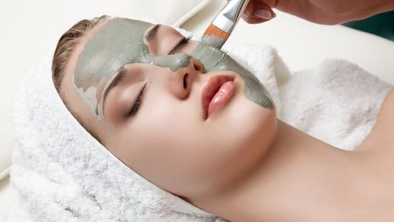 A customer receiving a facial